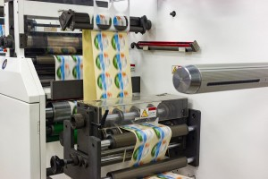 Punching and unrolling labels on a roll